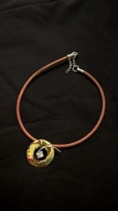 Cerchio ottone con virgola argento e zircone