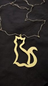 Gatto traforato ottone