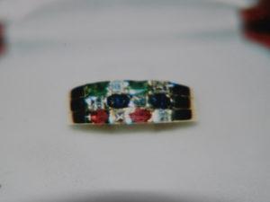 Anello con zirconi, zaffiri , rubini e smeraldi €. 163,00