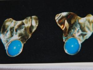 Orecchini in argento dorato con turchesi €. 127,00